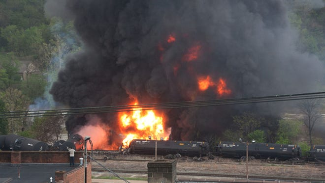 Several CSX tanker cars carrying crude oil are in flames after derailing April 30 in downtown Lynchburg, Virginia.