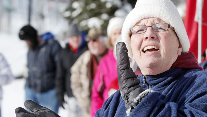 Diane Havrilla cheers on Special Olympians during the 200 meter snowshoe race at Perfect North Slopes in Lawrenceburg, Indiana, during the Special Olympics Indiana Winter Games.