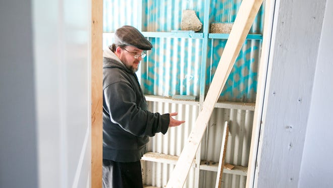 Jason Lindial shows the back door where burglars broke into his home in Salem on Tuesday, Jan. 24, 2017. Lindial and his partner Jetzabel Franco had just finished moving items into their new house last week, only to come home to find personal items, including his laptop with transcriptionist software and her heirloom jewelry, had been stolen.