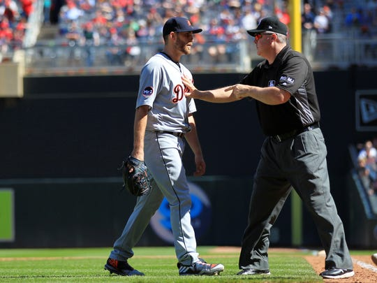 Tigers pitcher Matt Boyd is held back by first base umpire Mike Everitt in the fifth inning after the Twins' Miguel Sano pointed at Boyd following a hit-by-pitch April 22, 2017 at Target Field in Minneapolis.