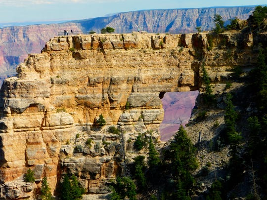 The natural arch known as Angels Window is one of the sights along the easy Cape Royal Trail on the North Rim.