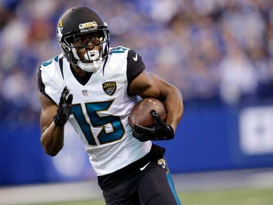 FILE - In this Jan. 1, 2017, file photo, Jacksonville Jaguars wide receiver Allen Robinson (15) runs after a catch during the first half of an NFL football game against the Indianapolis Colts in Indianapolis. The Jaguars are not expected to use the franchise tag on free-agent receiver Allen Robinson, raising questions about the team's plan to revamp an offense that lacked play-makers in 2017. (AP Photo/AJ Mast, File)