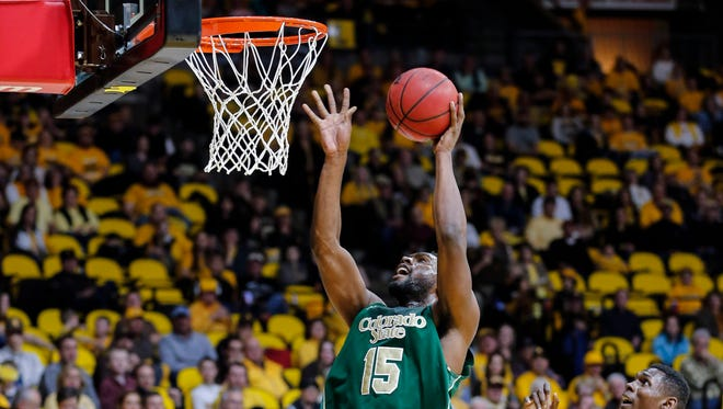 CSU's Tiel Daniels takes the ball to the rim as teammate Emmanuel Omogbo looks on during a Jan. 30 game at Wyoming. Daniels scored 15 points and Omogbo 11 in that game, which the Rams lost 83-76. The teams meet again Saturday at Moby Arena.