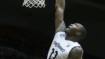 Coreontae DeBerry, here dunking against Tulane, is among four University of Cincinnati seniors who are looking to finish strong.