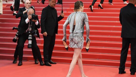 Kristen Stewart heads towards the famed Palais stairs.