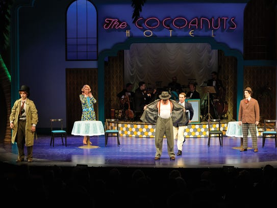 "The cast of ""The Cocoanuts"" performs a musical number"