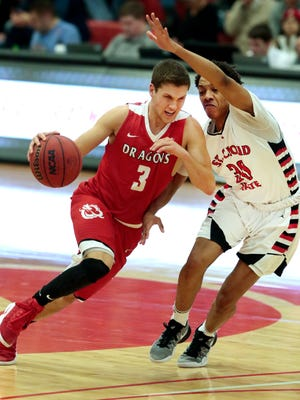 Tanner Kretchman of Minnesota State-Moorhead drives past Mark Hall of St. Cloud State in NSIC men's basketball action Saturday night in Moorhead.