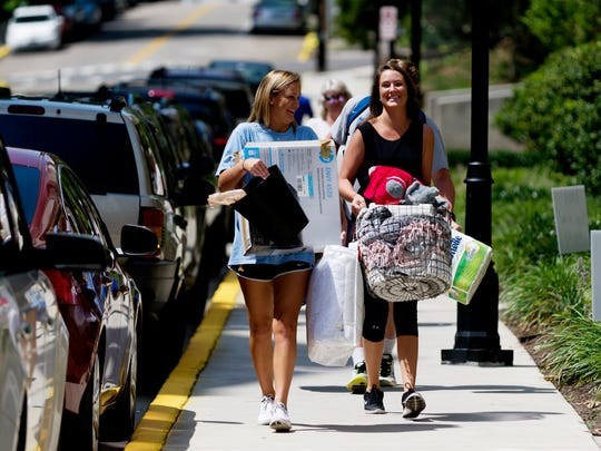 Kerry Webb, a sophomore studying finance and of Orlando, Florida, and her sister Erin Webb carry belongings during move-in day at The Knox student housing on 1511 Clinch Ave. in Knoxville, Tennessee on Wednesday, August 16, 2017. The 101-room complex features a hot tub, outdoor seating area and grilling amenities.