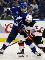 New Jersey Devils right wing Kyle Palmieri (21) hits