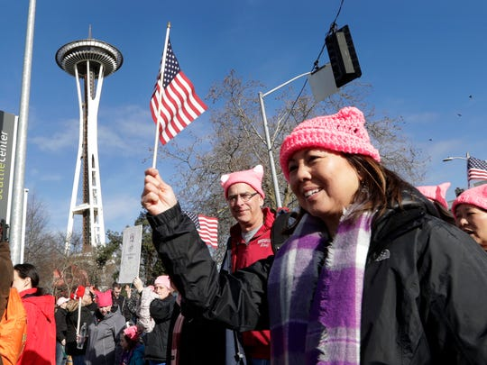 Marchers numbering in the thousands arrive at the Seattle Center and in view of the Space Needle on Jan. 21, 2017, in Seattle. Women across the Pacific Northwest marched in solidarity with the Women's March on Washington and to send a message in support of women's rights and other causes.