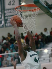 Peabody's Troy Jones (44) puts up two against ASH in a 2012 game.