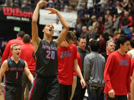 South Salem's Khalid Thomas and teammates celebrate after defeating Clackamas 82-74 in overtime in the first round of the OSAA Class 6A state basketball tournament Thursday, March 10, 2016, at the Chiles Center at University of Portland.
