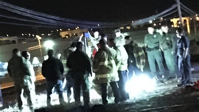 U.S. Border Patrol agents and El Paso firefighters on Monday night work at the scene of a drainage entrance on West Franklin Avenue west of Southwest University Park.
