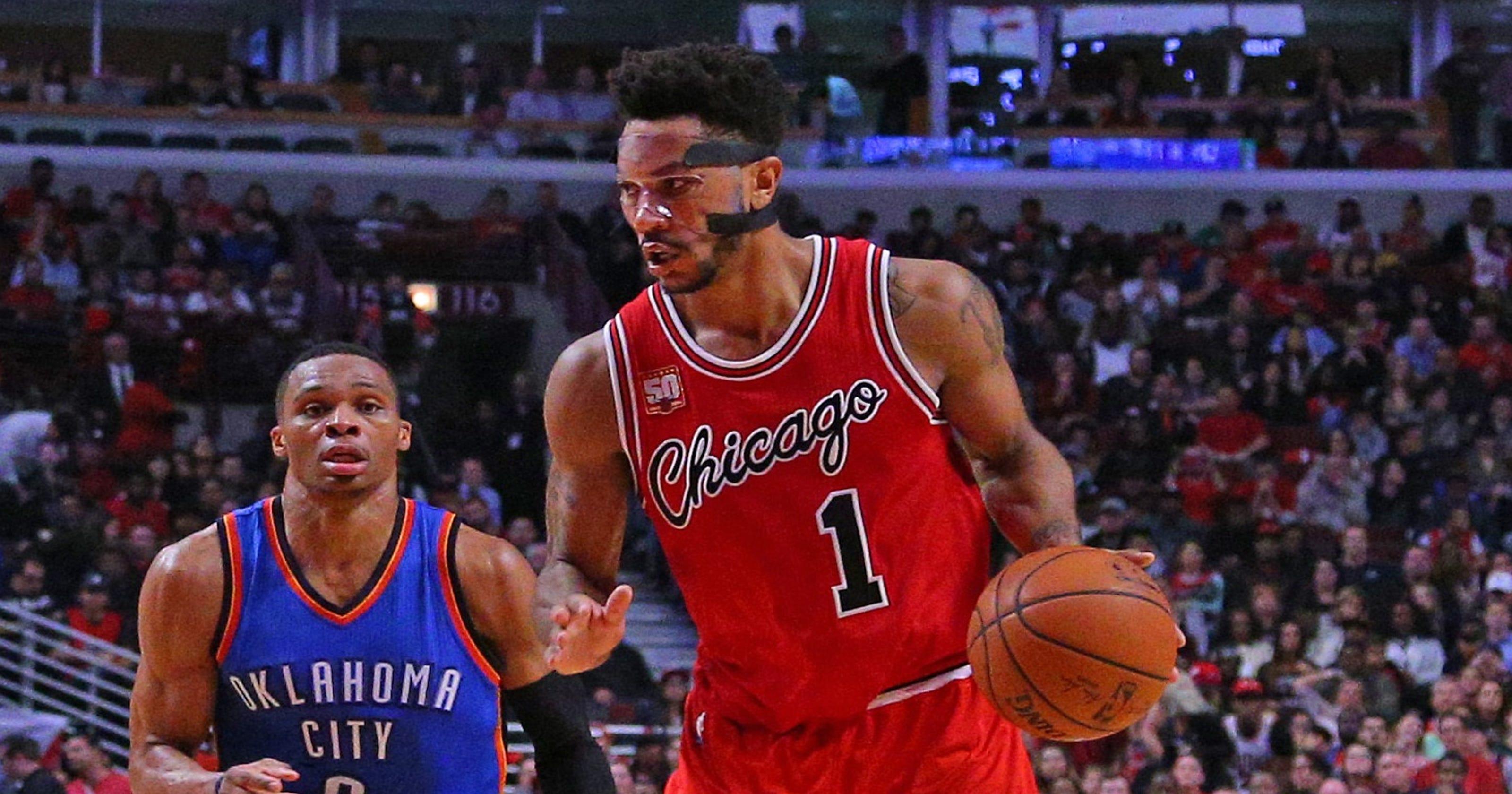 862c24382460 Derrick Rose s late surge pushes Bulls past Thunder