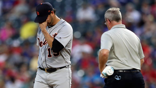 Tigers pitcher Anibal Sanchez (19) reacts after injuring himself during the third inning on Wednesday, Aug. 16, 2017, in Arlington, Texas.