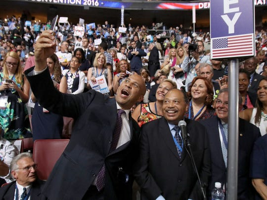U.S. Sen. Cory Booker takes a selfie with State Democratic Chairman John Currie (center) and fellow U.S. Sen. Robert Menendez at the Democratic National Convention in Philadelphia Tuesday.