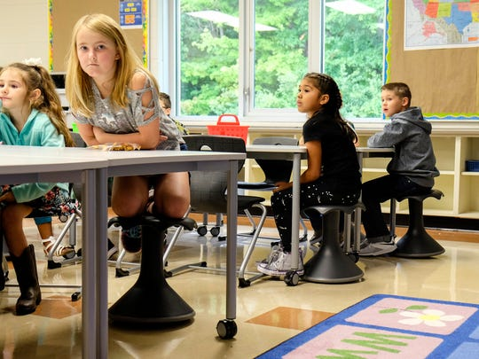 Kids in Michelle Cuppen's second grade class at Michigamme Elementary sit on the new Hokki stools on the first day of school, Sept. 5. The stools are part of the new furniture the school received as part of the renovations that took place this summer.