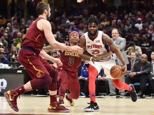 Pistons forward Reggie Bullock (25) drives to the basket