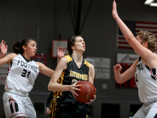 Enterprise's Aly Burke goes to the hoop between Foothill's