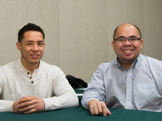RVCC student Carlos Pareja (left) chats with his Sanofi mentor Jeffrey Seguritan during a meeting at RVCC's Branchburg campus.