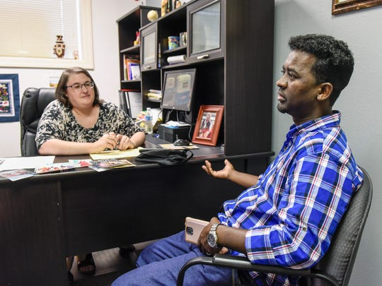 Laura Tripiciano, Tripiciano immigration Law Office is helping Abdikarim Osman Omar get his wife and five children here from Kenya Friday, July 6, because of the national travel ban.