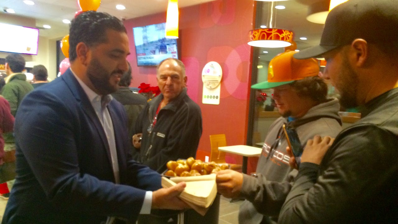 It was 9 p.m. Monday when Dunkin' Donuts staff began making doughnuts. It was 45 degrees outside under cloudy skies.  Joe Capito was already in line. The Westlake Village resident had been there for 10 hours. He had eight more hours to go.