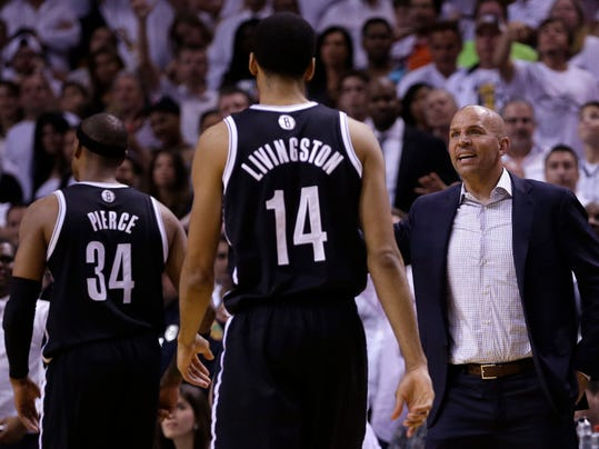 Brooklyn Nets head coach Jason Kidd, right, talks to his players as they head in for a timeout during the second half of Game 5 of a second-round NBA playoff basketball game against the Miami Heat in Miami, Wednesday, May 14, 2014. The Heat won 96-94. (AP Photo)
