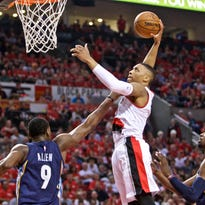 Apr 27, 2015; Portland, OR, USA; Portland Trail Blazers guard Damian Lillard (0) shoots over Memphis Grizzlies forward Tony Allen (9) during the second quarter in game four of the first round of the NBA Playoffs at the Moda Center. Mandatory Credit: Craig Mitchelldyer-USA TODAY Sports