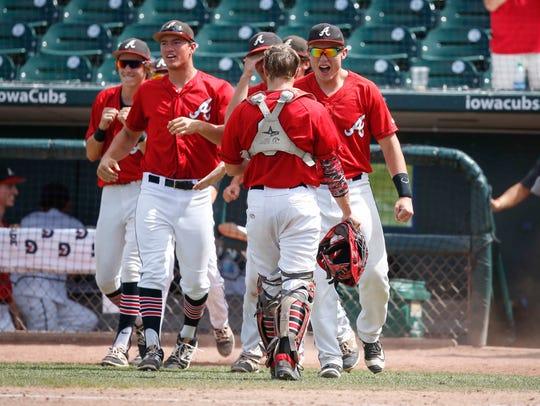 Members of the Davenport Assumption baseball team celebrate