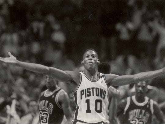 Dennis Rodman greets victory with open arms. He led the Pistons with 14 rebounds against the Bulls.