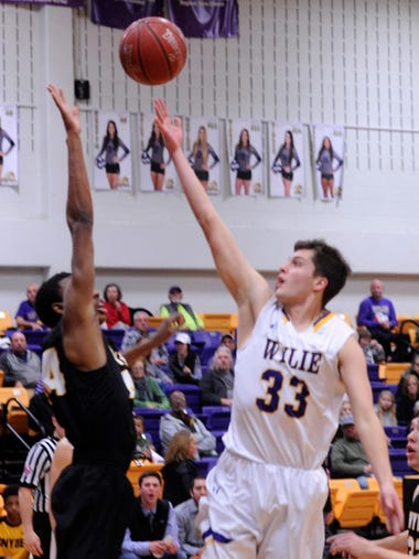 Thomas Lynch finishes in the lane for a basket during