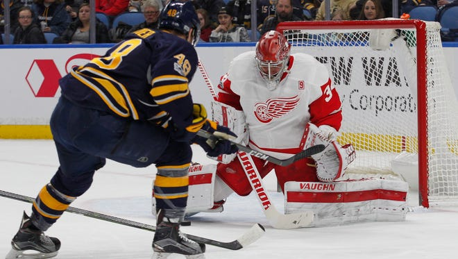 Buffalo Sabres forward William Carrier (48) is stopped by Detroit Red Wings goalie Petr Mrazek (34) during the first period.