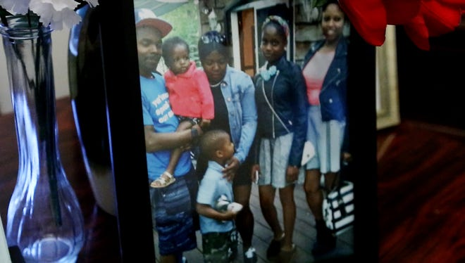 The last photo Anthony Garrett's mother has of him was taken during a family gathering this summer.