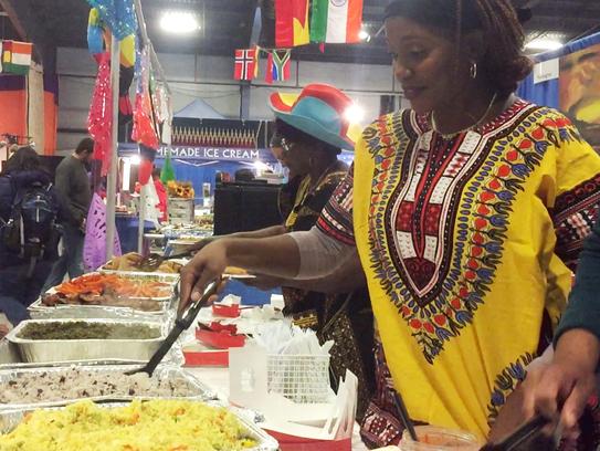 Mireille Dasilva, right, and Jackie Abeneto serve food