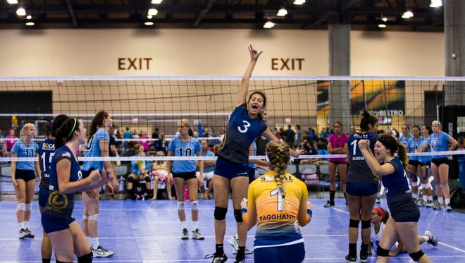 SoCal's Briana Sizemore celebrates with her team during the annual Volleyball Festival at the Phoenix Convention Center in Phoenix, AZ on Saturday, June 28, 2014.