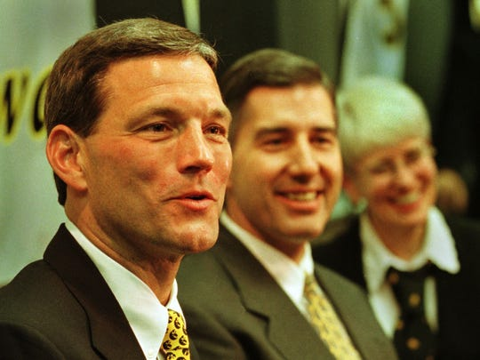 Kirk Ferentz is shown at his introductory press conference at Iowa, with then-athletics director Bob Bowlsby, in December 1998.