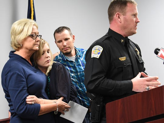 Pam Isbell, left, gets a hug from her daughter Jennifer Rigdon, right, and Shafford Rigdon , as Chad McBride, Anderson County Sheriff, announced progress in the case of the 2015 quadruple homicide on Refuge Road in Pendleton. Her mother Barbara Scott, was killed with Mike and Cathy Scott, and Violet Taylor.