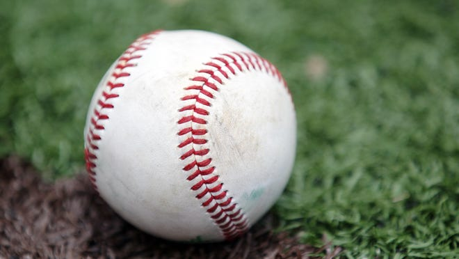 """A baseball is pictured on the field Thursday, June, 5, 2014, during UL baseball practice at M.L. """"Tigue"""" Moore Field in Lafayette, La."""