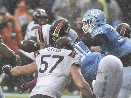 Virginia Tech Hokies quarterback Jerod Evans (4) fumbles