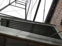 Steel girders from an old water tower are still in place on South Patton Avenue downtown.