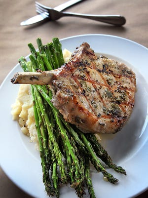 A perfect pork chop at The Local Eatery and Pub in Westfield. Owner Craig Baker is among 10 chefs cooking for the Pig & Pinot dinner Sept. 13 at Oakley's Bistro.