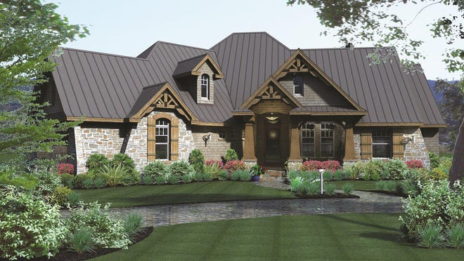 The Craftsman-inspired exterior displays rugged curb appeal with a series of gables and decorative trusses.