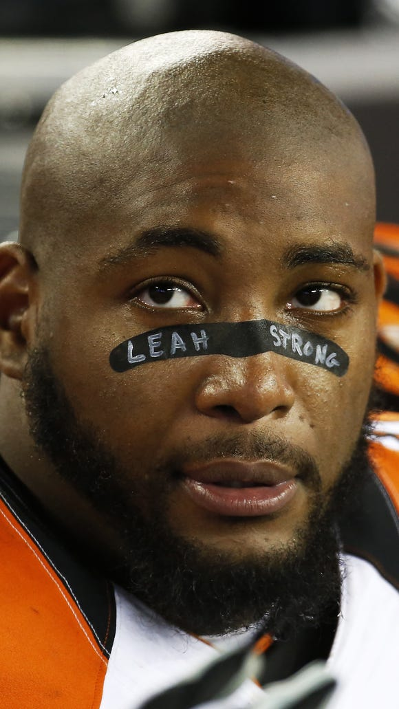 "Cincinnati Bengals defensive tackle Devon Still (75) wears ""Leah Strong"" on his eye black in honor of his daughter who is fighting cancer. The New England Patriots honored their family during the game at Gillette Stadium."