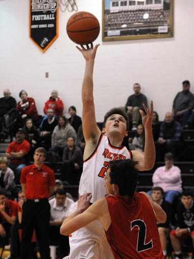Amanda-Clearcreek's Andrew Hunter takes a shot over
