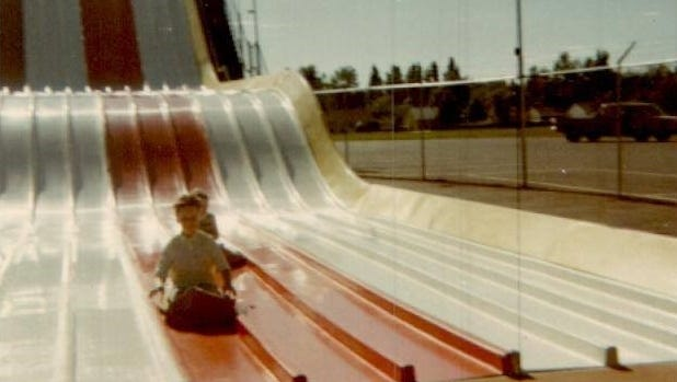 Jean Ahrens (front) and her sister Judy Vogel slide down Earl Britt's Magic Carpet Slide in about 1968.