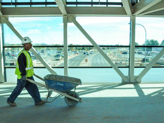 Wooten construction worker Tony Ortiz walks with a