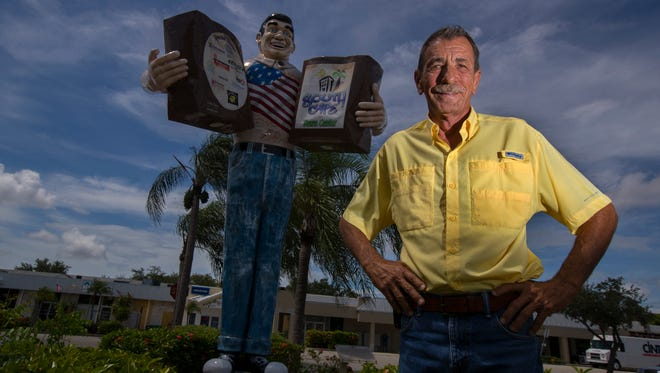 Elmer Tabor Jr. poses by the Big John statue in downtown Cape Coral. His father opened the first grocery store in Cape Coral in 1962 at that location.