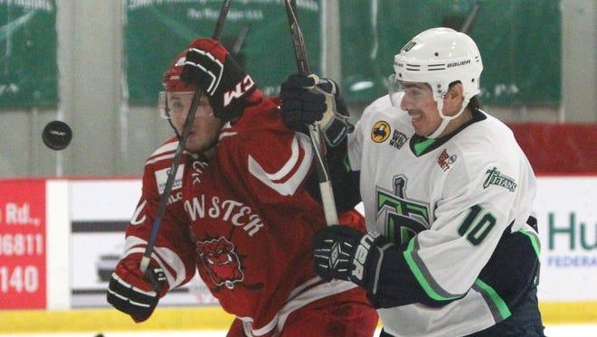Brewster Bulldogs's Dan Loughlin, left, fights to get past Danbury Titans' Justin Apcar-Blaszak during their Federal Hockey League game at Brewster Ice Arena Nov. 6, 2015.