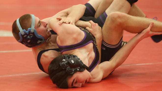 From left, Suffern's Patrick Canty on his way to defeating Clarkstown North's Mike Arciero in the 126-pound weight class of the Rockland County Wrestling Championship at Tappan Zee High School Jan. 30, 2016
