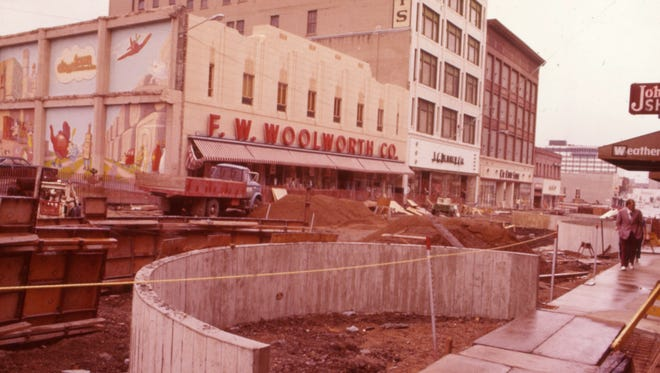 Mike Lynch created a six-panel mural on the side of the former Woolworth's building at 10th and Phillips in 1973.